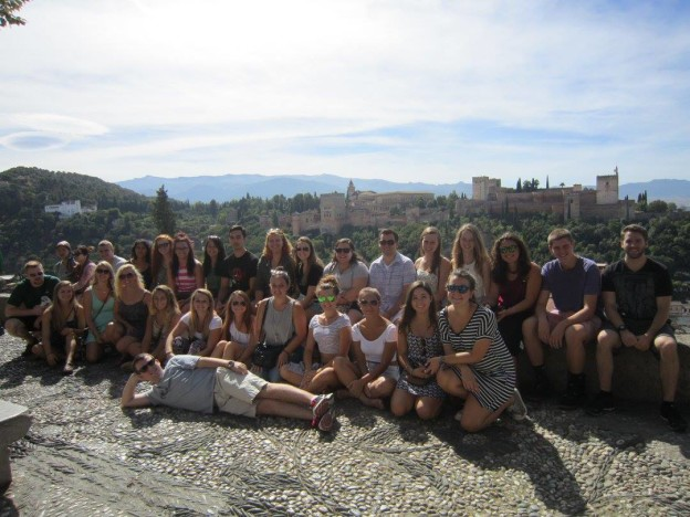 UNE students at the Mirador de San Nicolas. Alhambra and Sierra Nevada mountains in the background.